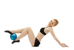 Young gymnast play with blue ball Royalty Free Stock Photo