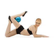 Young Gymnast Posing With Blue Ball Stock Photo