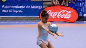 Young gymnast on rhythmic gymnastics tournament with ball stock video
