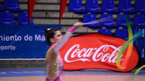 Young gymnast with ribbons on rhythmic gymnastics tournament stock video