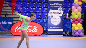 Young gymnast with ring on rhythmic gymnastics tournament stock video