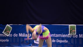 Young gymnast with ring on rhythmic gymnastics tournament stock footage