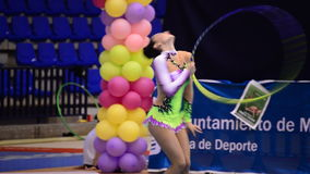Young gymnast with ring on a rhythmic gymnastics tournament stock video footage