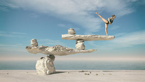 Young gymnast sitting on stones Stock Photos