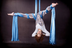 Young gymnast soars on aerial silk. Young gymnast soars upside down on aerial silk Royalty Free Stock Photos
