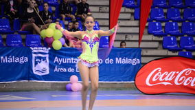 Young gymnast with string on rhythmic gymnastics tournament stock video footage
