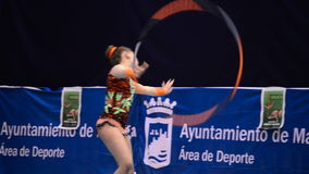 Young gymnast with string on rhythmic gymnastics tournament stock footage
