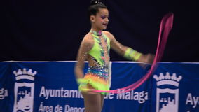 Young gymnast with string on rhythmic gymnastics tournament stock video