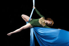 Young gymnast training on aerial silk. Young gymnast training balance on aerial silk Royalty Free Stock Images