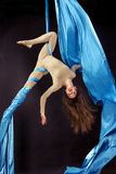 Young gymnast training on aerial silk. Young gymnast doing exercise on aerial silk Stock Photos