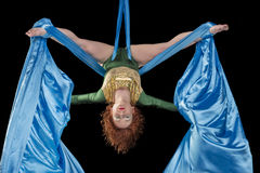 Young gymnast training on aerial silk. Young gymnast training endurance on aerial silk Stock Photography