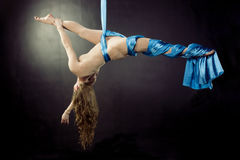 Young gymnast training on aerial silk. Young gymnast training flexibility and balance on aerial silk Stock Photography