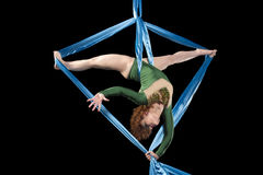 Young gymnast training on aerial silk. Young gymnast training flexibility and handstand on aerial silk Stock Images