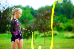 Young gymnast warms up with a gymnastic tape or Stock Images