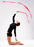 Young gymnast woman training with a ribbon Stock Photography