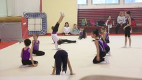Young gymnasts jumps in training stock video footage