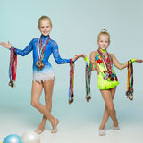Young gymnasts with medals royalty free stock images
