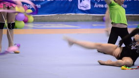 Young gymnasts practicing in court in rhythmic gymnastics tournament stock video