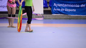 Young gymnasts practicing with ribbons in court in rhythmic gymnastics tournament stock footage