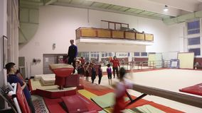 Young gymnasts in training stock video footage