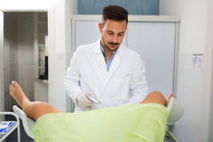 Young gynecologist exam his patient at clinic Royalty Free Stock Photography
