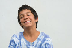 Young gypsy boy funny expression Stock Images