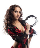 Young gypsy girl play with tambourine Stock Image
