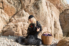 Young gypsy on the rocky beach Stock Images