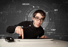 Young hacker in futuristic enviroment hacking personal informati Stock Photo