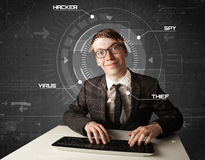 Young hacker in futuristic enviroment hacking personal informati Royalty Free Stock Image