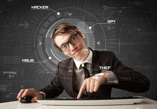 Young hacker in futuristic enviroment hacking personal informati Stock Photo