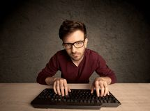 Computer geek typing on keyboard Royalty Free Stock Photo