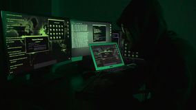 Young hacker man programmer in his black digital business work. stock video footage