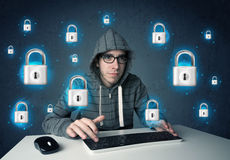 Young hacker with virtual lock symbols and icons Stock Images