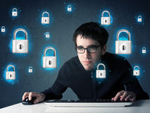 Young hacker with virtual lock symbols and icons Stock Image