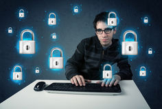 Young hacker with virtual lock symbols and icons Royalty Free Stock Photo