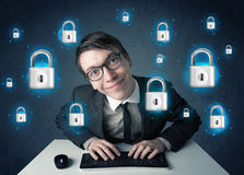 Young hacker with virtual lock symbols and icons Royalty Free Stock Photos