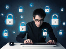 Young hacker with virtual lock symbols and icons Royalty Free Stock Images