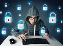 Young hacker with virtual lock symbols and icons Stock Photos