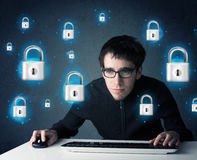 Young hacker with virtual lock symbols and icons Royalty Free Stock Photography