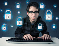 Young hacker with virtual lock symbols and icons Stock Photo