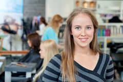 Young Hairdresser Smiling Stock Photo