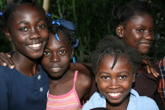 Young Haitian girls pose for camera in rural village. Royalty Free Stock Photos