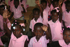 Young  Haitian school girls and boys in classroom at school. Royalty Free Stock Images
