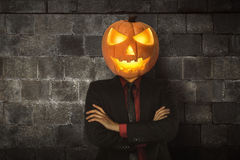 Young halloween man wearing suit with pumpkin head Royalty Free Stock Photography