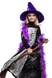 Young Halloween witch with a broom Stock Image