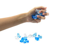 Young hand hold many colour ice Stock Image