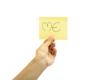 Young hand hold some word on yellow  paper Royalty Free Stock Photography
