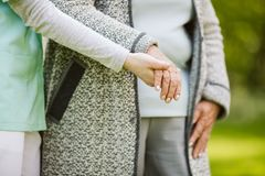 Young hand holding elderly. Help for the elder woman royalty free stock photography
