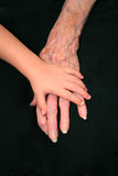 Young Hand on Old Hand Royalty Free Stock Photos